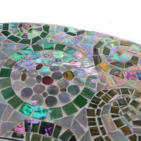 Close up of round mosaic mirror